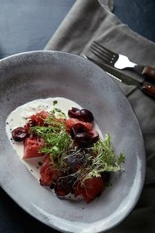Watermelon salad with mozzarella, beautiful table setting