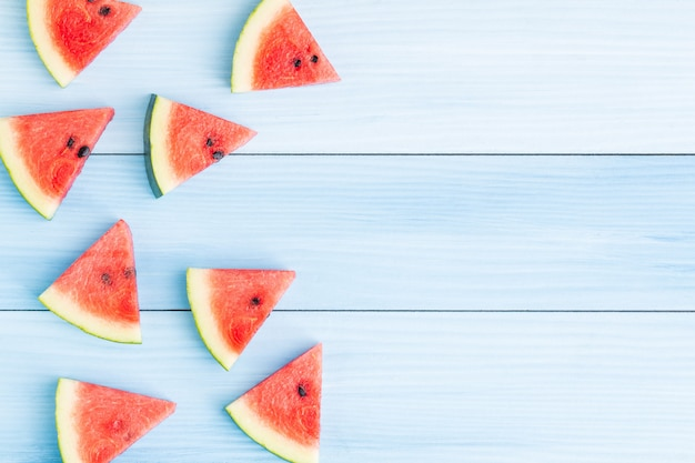 Watermelon slice on blue wood background