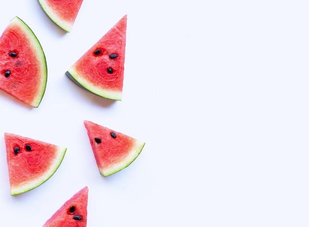 Watermelon sliced on white.