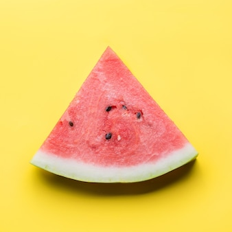 Watermelon sliced on yellow. flat lay. food concept.