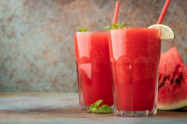 Watermelon slushie summer refreshing drink in tall glasses.