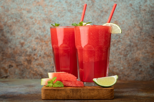 Watermelon slushie summer refreshing drink in tall glasses.