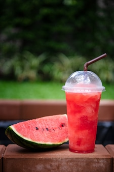 Watermelon smoothie with fresh watermelon slices