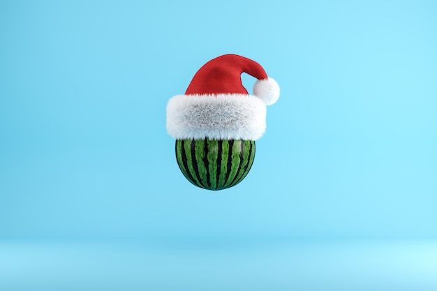 Watermelon with santa hat floating on blue