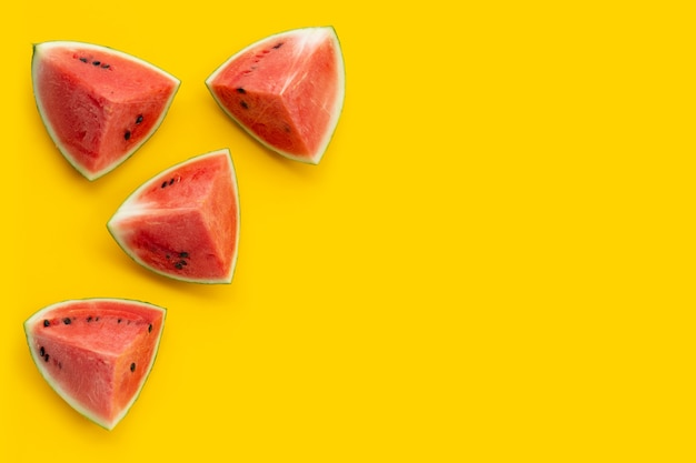 Watermelon on yellow background. copy space