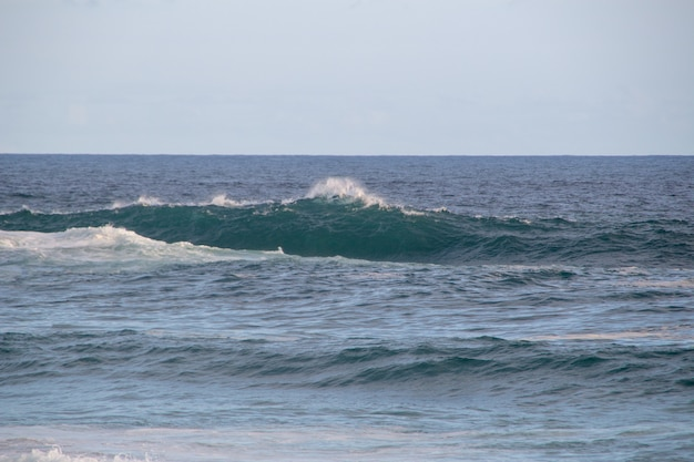 Wave breaking on the third slab of arpoador beach in rio de janeiro.