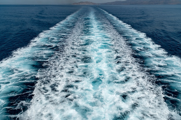 Wave ocean trace blue sea fresh water. deep ocean water surface trail bubble foaming.
