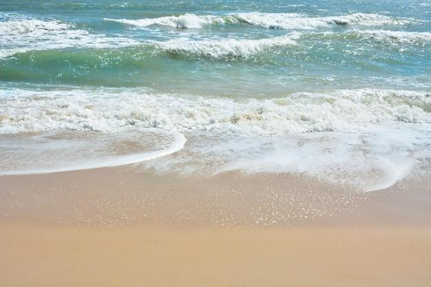 Wave of the sea on the sand beach,  beach and tropical sea, paradise idyllic beach.