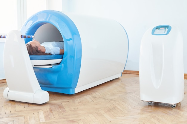 Wave therapy. the magnetic field, rehabilitation. a woman uses a magnetic therapy system to treat and prevent diseases.