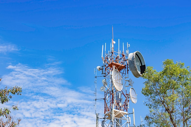 Wave transmission mast, large phone signal with a bright blue sky
