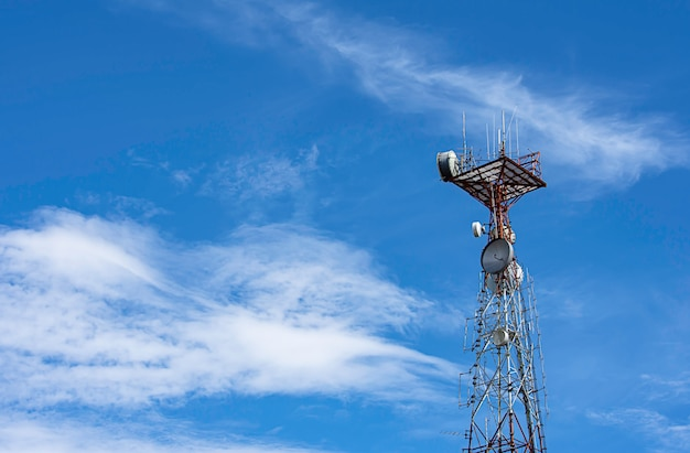 Wave transmission mast large phone signal with a bright blue sky.