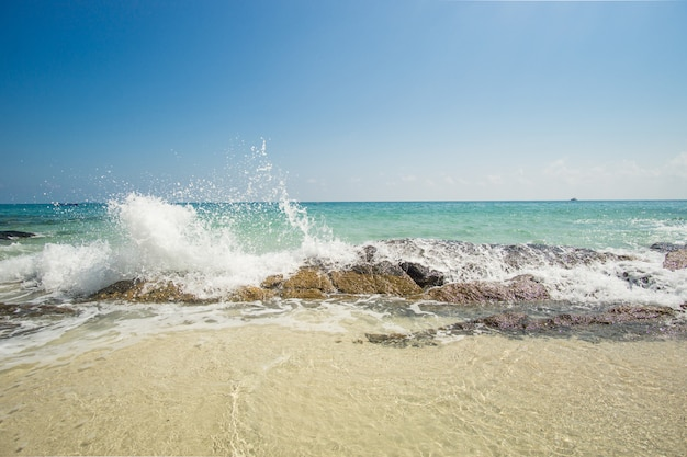 Waves breaking on the rock on the caribbean beach