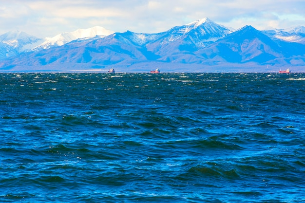 Waves, mountains and volcanoes in the pacific ocean avacha bay kamchatka