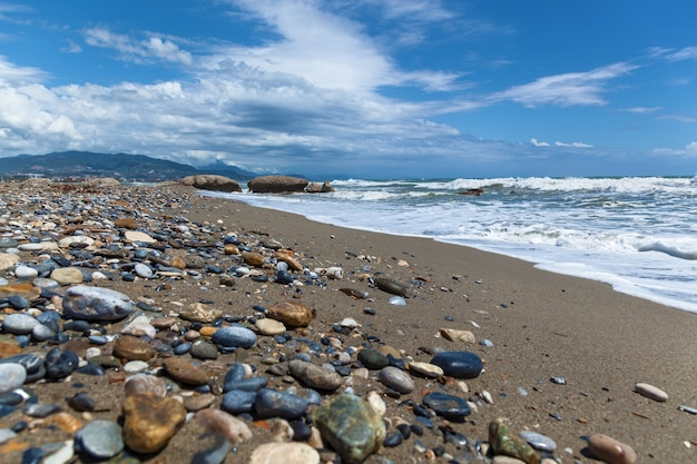 Waves on pebble beach of mediterranean sea turkey in autumn alanya natural background