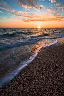 Waves at sea at sunset