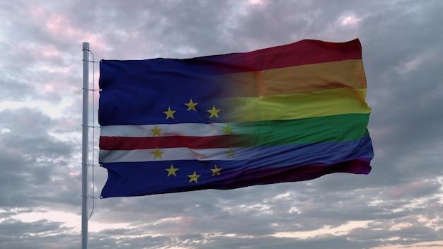 Развевающийся флаг штата кабо-верде и радужный флаг лгбт