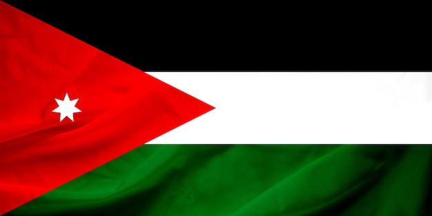 ヨルダンの旗を振る。旗は本物の生地の質感を持っています。