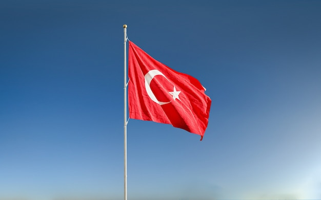 Waving turkish flag in the blue sky