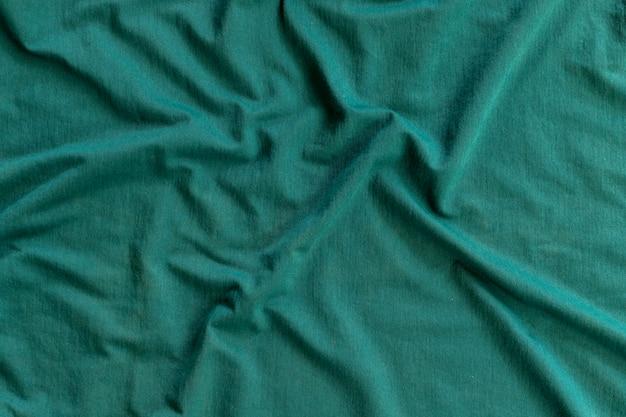 Wavy greenish fabric texture. abstract