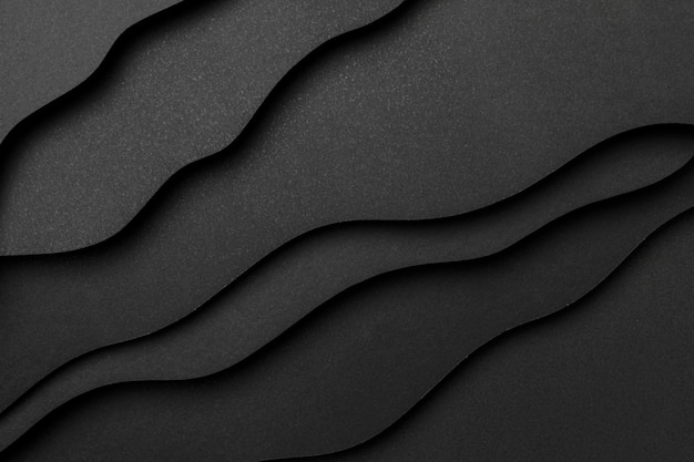 Wavy layers of black paper background