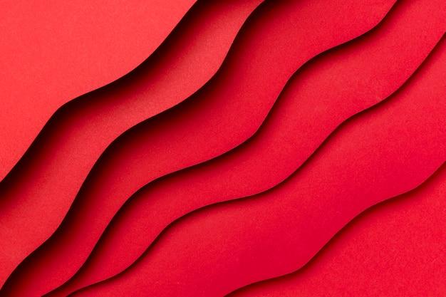 赤い背景の波状のレイヤー