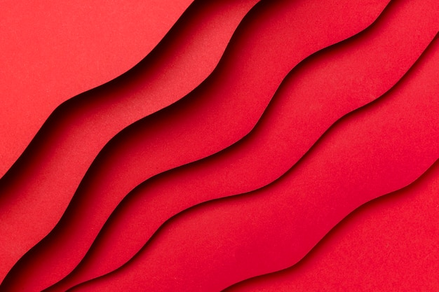 Strati ondulati di sfondo rosso