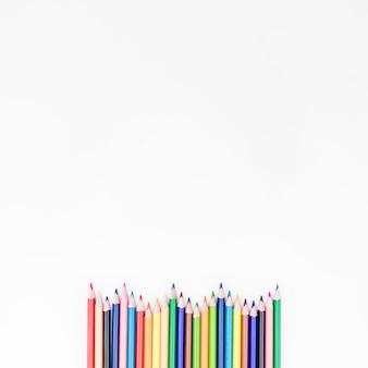 Wavy line of colored pencils