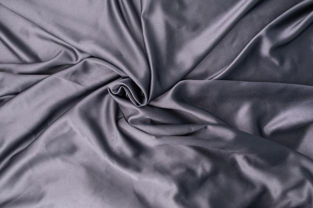 물결 모양의 파문이 회색 파란색 보라색 실크 새틴 패브릭 추상적 인 배경