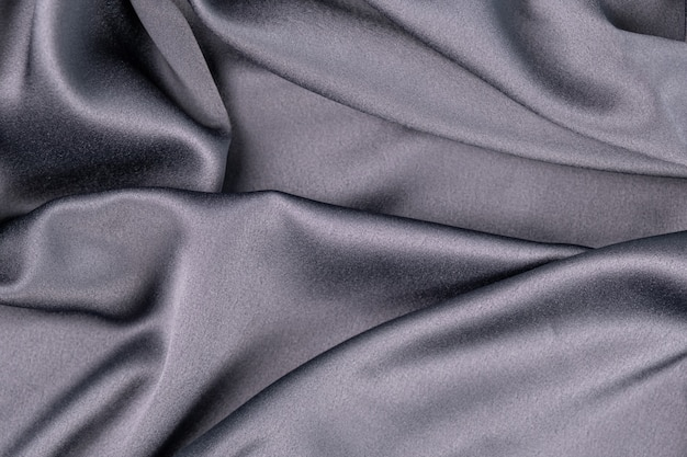 Волнистые волнистые серые синие фиолетовые шелковые атласные ткани абстрактный фон