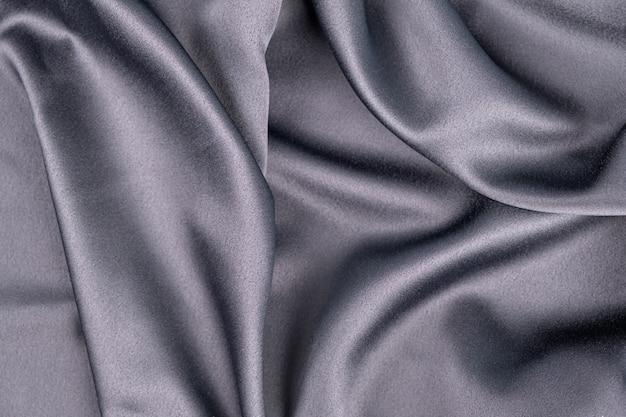 Wavy rippled gray blue purple silk satin fabric background