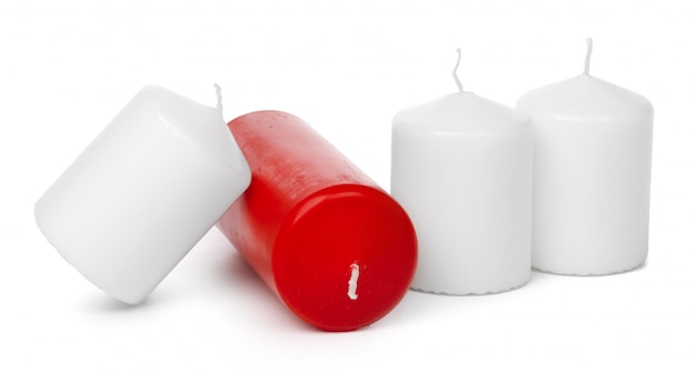 Wax colored candle  on white background close up
