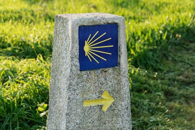 Way of st. james sign. yellow scallop sign pilgrimage to santiago de compostela