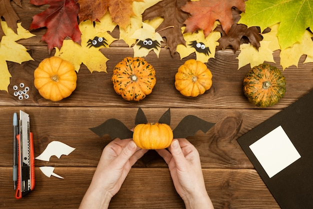 We make gifts for halloween. making a funny bat out of a small yellow pumpkin. halloween party decor. diy instruction. step by step guide. step 7.