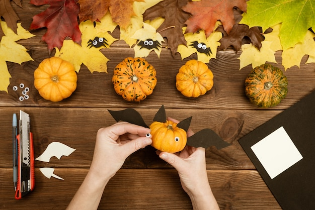 We make gifts for halloween. making a funny bat out of a small yellow pumpkin. halloween party decor. diy instruction. step by step guide. step 8.