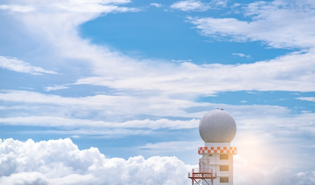 Weather observations radar dome station against blue sky and white fluffy clouds. aeronautical meteorological observations station tower. spherical tower.