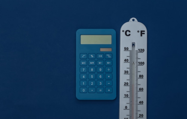 Weather thermometer and calculator on classic blue background. color 2020. tiop view