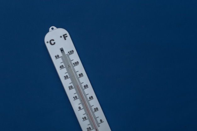 Weather thermometer on classic blue background. color 2020. tiop view
