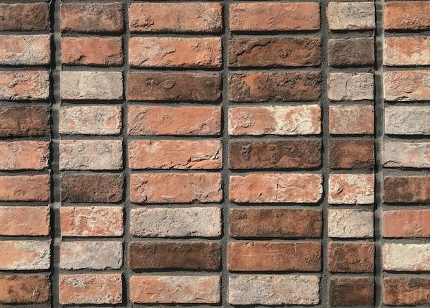 Weathered brown brick blocks wall for vintage design background.