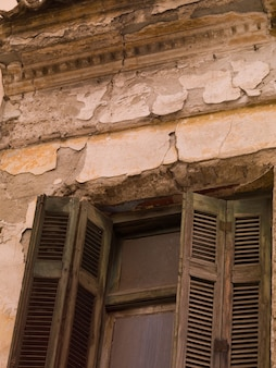 Weathered building exterior in athens greece