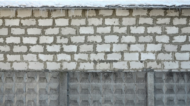 Weathered old white brick wall texture