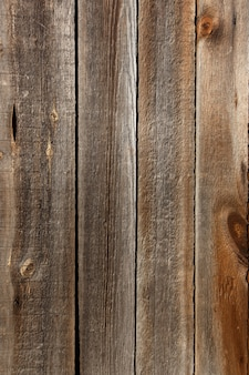 Weathered wooden wall fragment closeup shot, abstract texture.