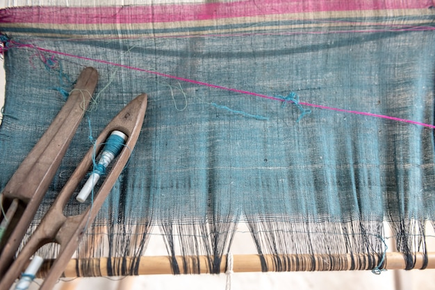 Weave and thai silk. activity involving skill in making things by hand