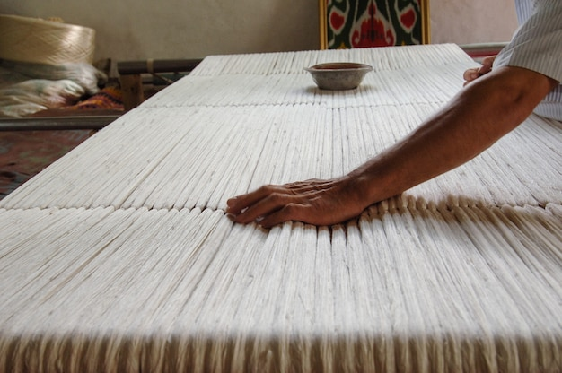 Weaving and manufacturing of handmade carpets closeup