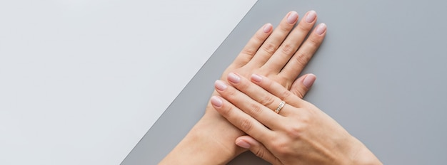 Web banner with female pink manicure