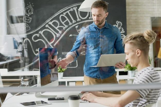 Web developers working in modern office