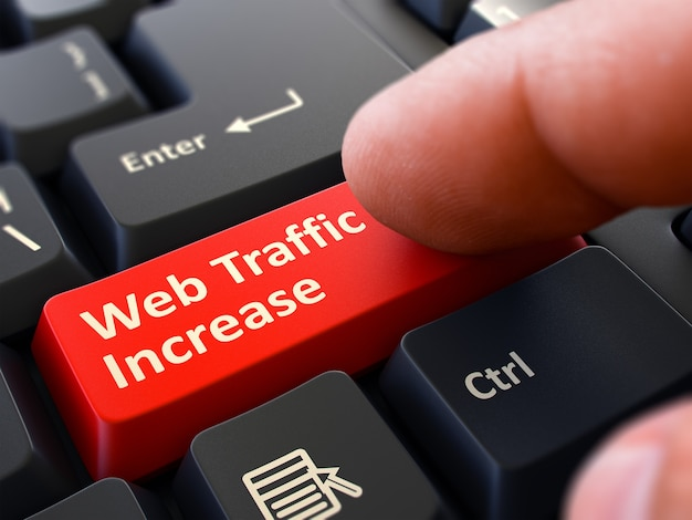 Web traffic increase - written on red keyboard key. male hand presses button on black pc keyboard. closeup view. blurred background. 3d render.