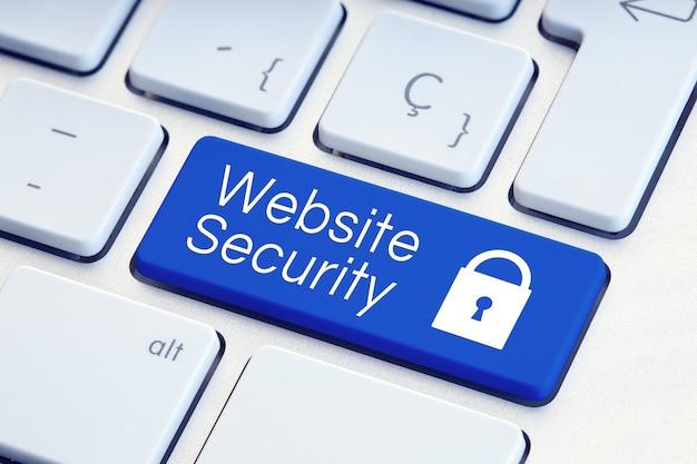 Слово безопасности веб-сайта и значок замка на синей компьютерной клавиатуре
