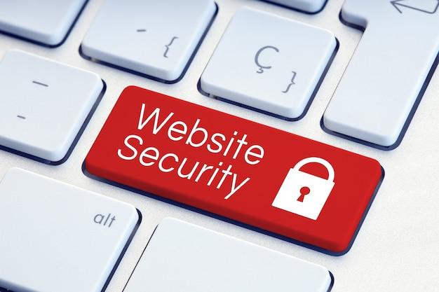 Слово безопасности веб-сайта и значок замка на красной компьютерной клавиатуре