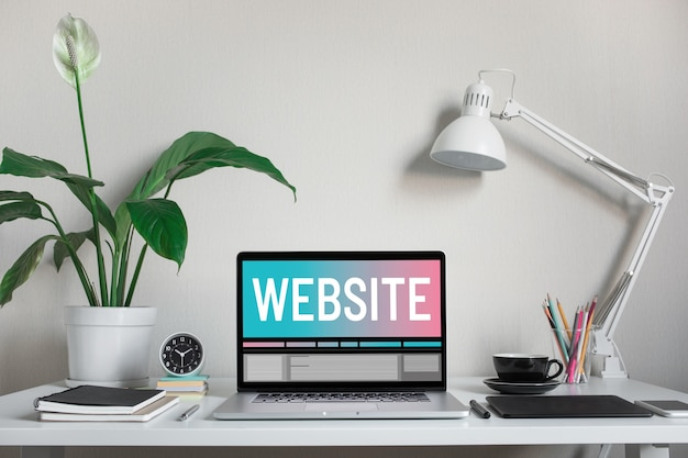 Website or web design concepts with text on computer laptop and accessories