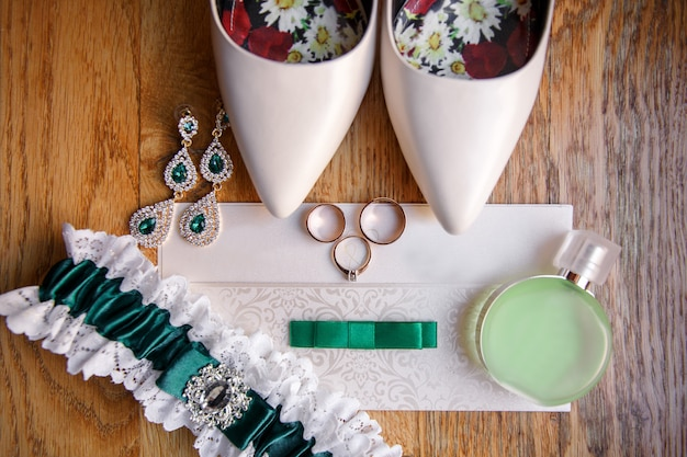 Wedding accessories for bride on wooden background